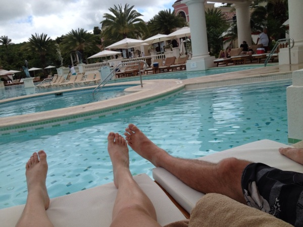 lounging poolside at sandals grande antigua